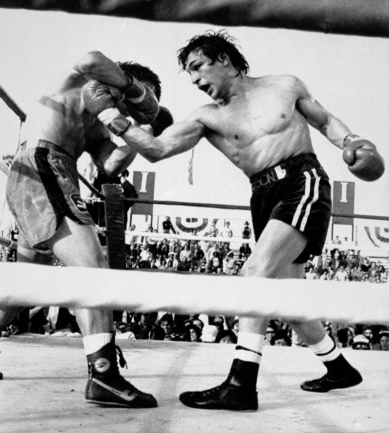 American boxer Ray 'Boom Boom' Mancini, right, throws a vicious right uppercut to the body of Duk Koo Kim during their World Boxing Association lightweight title bout in Las Vegas, Nev., Nov 13, 1982. Mancini knocked out the challenger in the 14th round. Kim was taken to Desert Springs Hospital where he underwent surgery for bleeding to the brain. (AP Photo)