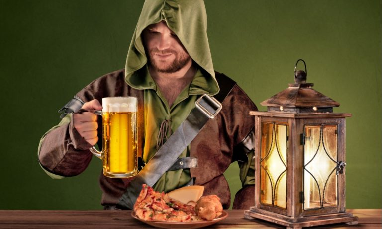 medieval-man-in-tavern-with-beer-on-the-vintage-background-picture-id484373245-768x460