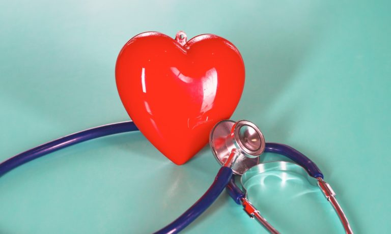 red-heart-with-stethoscope-on-blue-wooden-background-copy-space-day-picture-id962691568-768x460