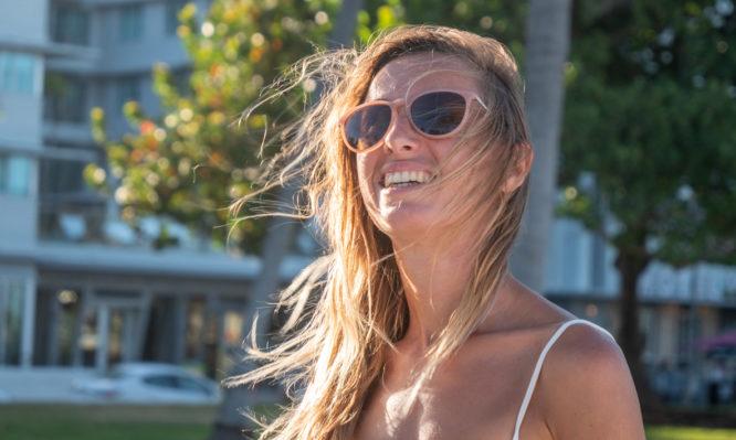 Woman walking on Ocean drive in Miami, sunset light