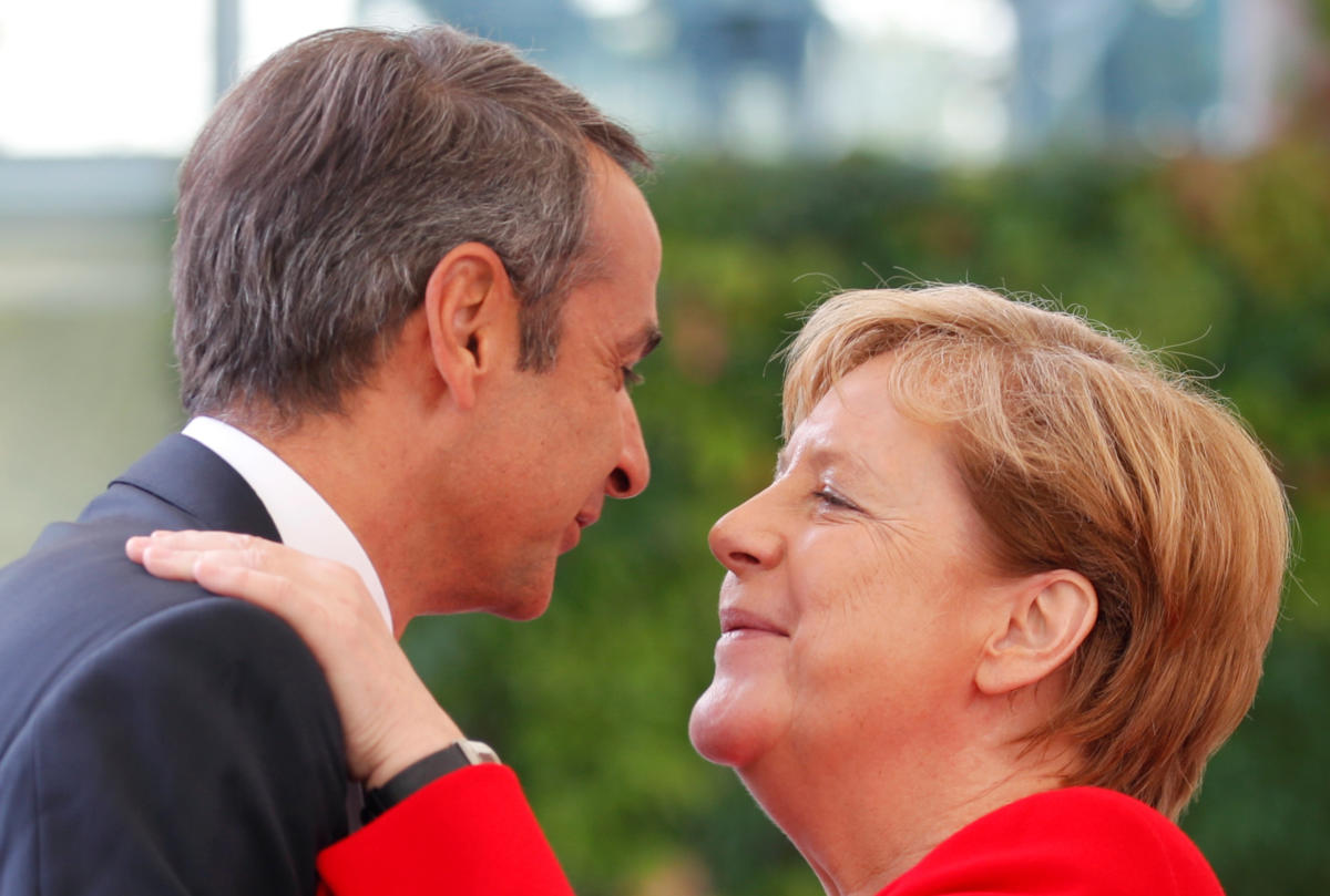 German Chancellor Angela Merkel greets Greece's Prime Minister Kyriakos Mitsotakis at the Chancellery in Berlin, Germany, August 29, 2019.   REUTERS/Axel Schmidt