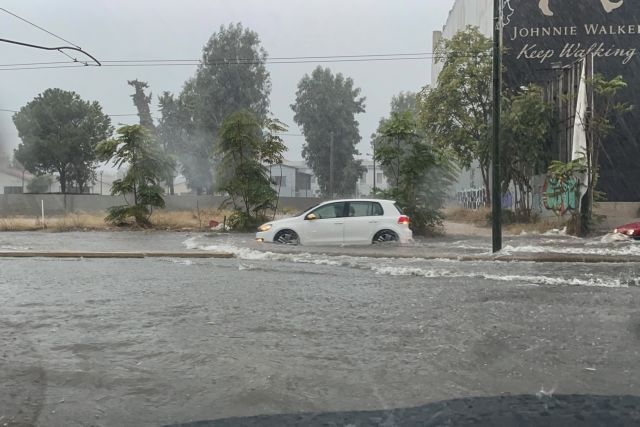 Extensive floods  due to heavy rain as «Balos» storm moves across the country, Piraeus Avenue, in Athens, Greece on October 14, 2021. / Εκτεταμένες πλημμύρες έπειτα από το πέρασμα της κακοκαιρίας «Μπάλλος», Οδός Πειραιώς, Αθήνα,στις 14 Οκτωβρη, 2021
