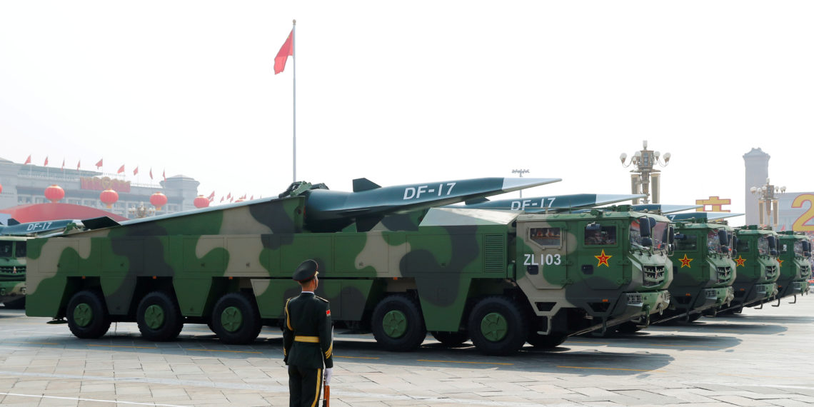 FILE PHOTO: Military vehicles carrying hypersonic missiles DF-17 drive past Tiananmen Square during the military parade marking the 70th founding anniversary of People's Republic of China, on its National Day in Beijing, China October 1, 2019.  REUTERS/Thomas Peter/File Photo
