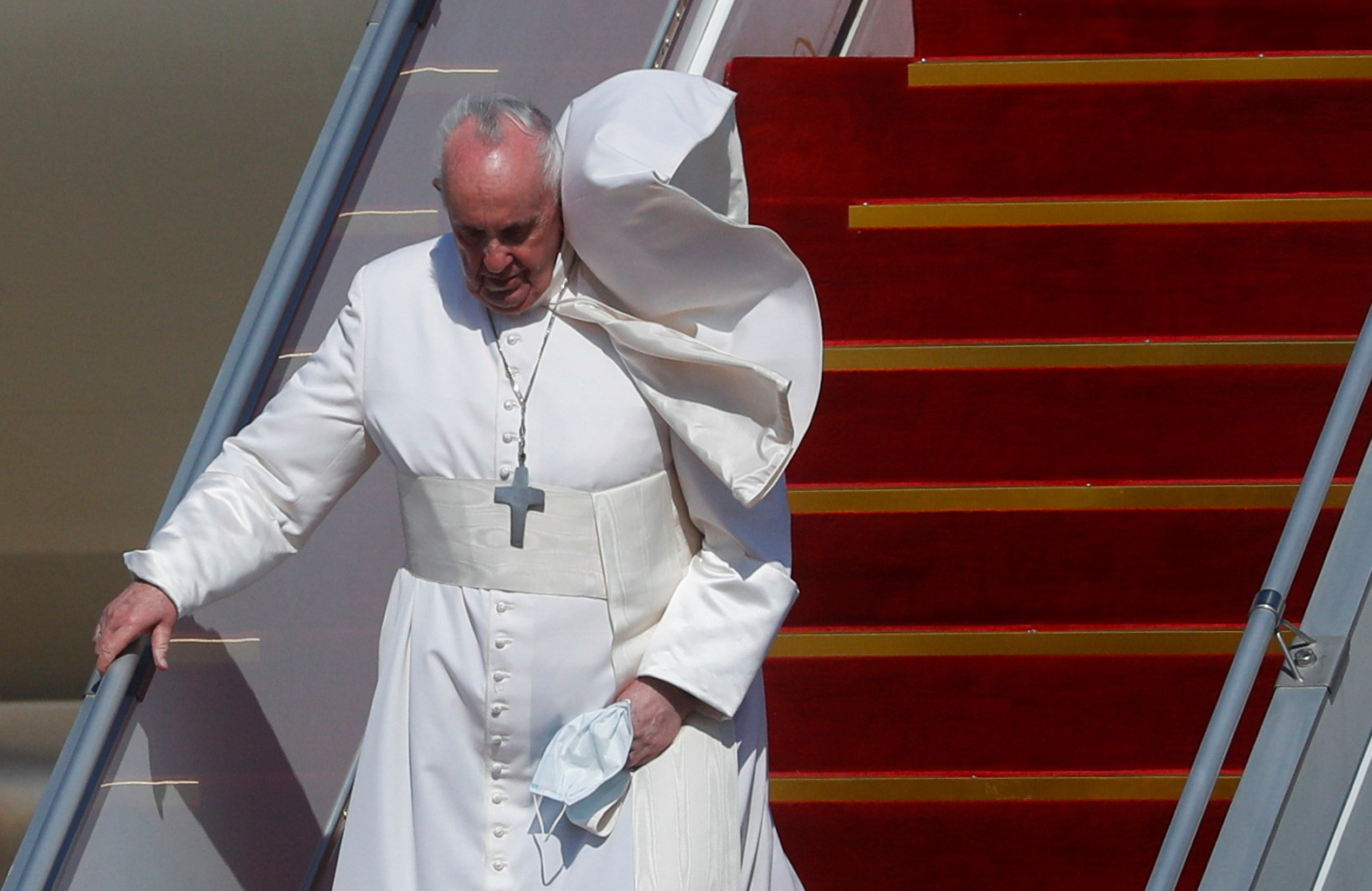 Pope Francis disembarks a plane as he arrives at Baghdad International Airport where a welcoming ceremony is held to start his historic tour in Baghdad, Iraq, March 5, 2021. REUTERS/Yara Nardi